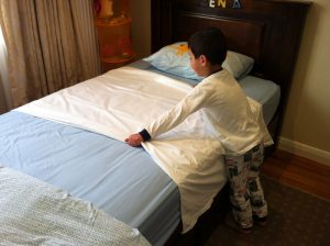 Place Up & Under over fitted sheet
